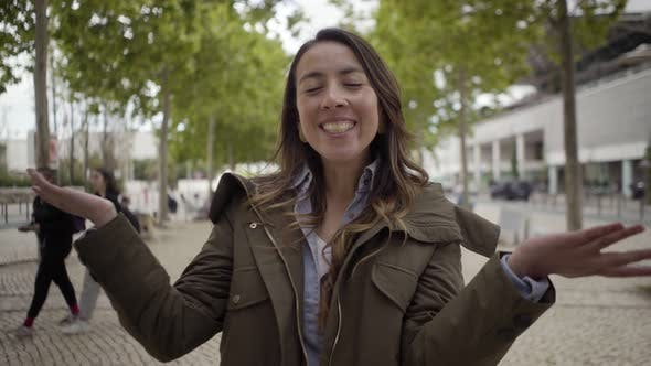 Thumbnail for Cheerful Beautiful Woman Talking To Camera During Stroll