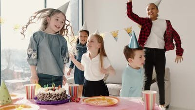 Group of Children Celebrating Birthday Party at Decorated Home