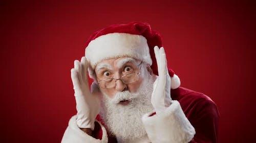 Santa Claus Making Peek a Boo