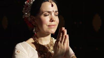 Hare Krishna Woman in Namaste Position