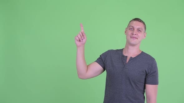 Thumbnail for Portrait of Happy Young Man Thinking and Pointing Up