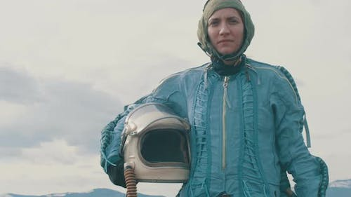 Woman Pilot With Helmet On Hand
