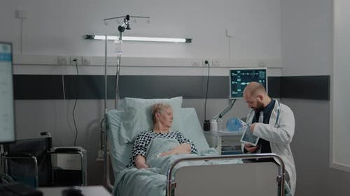 Doctor Holding Tablet with x Ray Scan for Healthcare Examination
