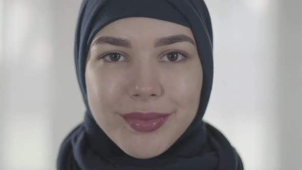 Thumbnail for Portrait of a Young Smiling Eastern Woman in the Modern Muslim Clothes and Beautiful Black Headdress
