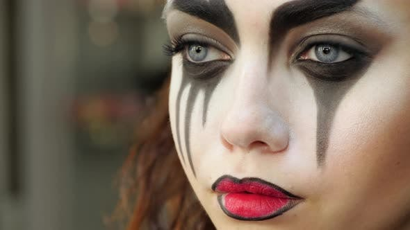 Thumbnail for Easy Halloween Makeup. Applying makeup to the face. Applying red paint on the lips