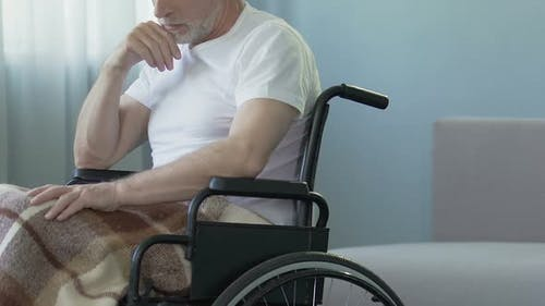 Aged Man Sitting in Wheelchair at Nursing Home, Feeling Lonely and Forgotten