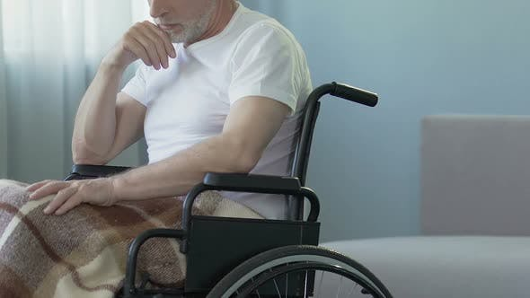 Thumbnail for Aged Man Sitting in Wheelchair at Nursing Home, Feeling Lonely and Forgotten