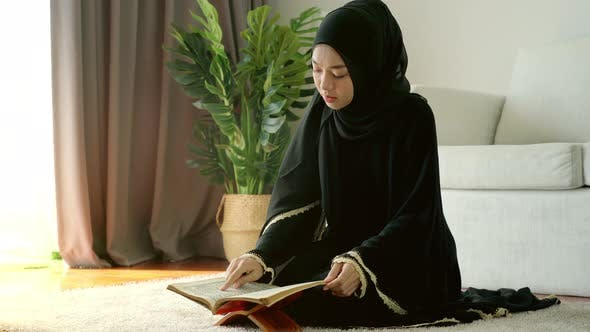 Asian Muslim Woman Reading the Qur'an