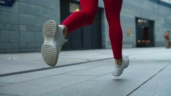 Thumbnail for Close Up Female Legs Jogging on Urban Street. Athlete Woman Legs Running Outdoor