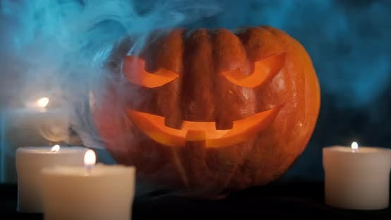 Thumbnail for Halloween Pumpkin On Dark Smoky Background