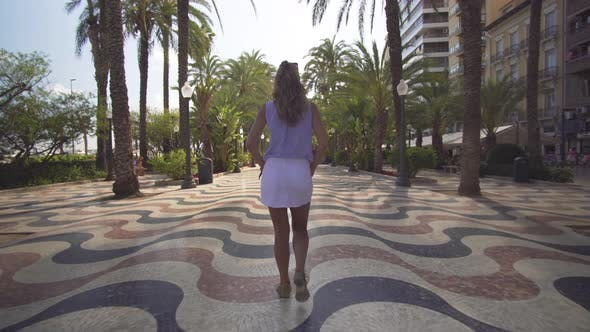 Thumbnail for Walk on a Sunny Day in the City Alicante. Girl Walk. Back View