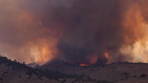 Time Lapse Forest Fire Burning Mountainside