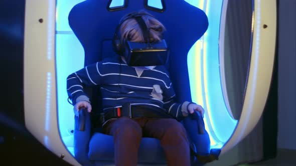 Thumbnail for Little Boy Experiencing Virtual Reality Sitting in Interactive Moving Chair