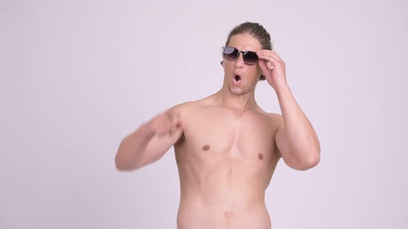 Thumbnail for Muscular Shirtless Man Looking Surprised and Removing Sunglasses
