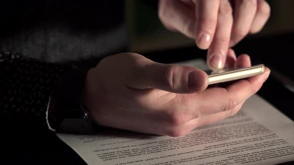 Close Up Shot of a Rich Man's Hands, Which Scans Web Page on His Smartphone.