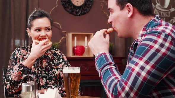 Thumbnail for Couple Eats Pizza and Drinks Beer