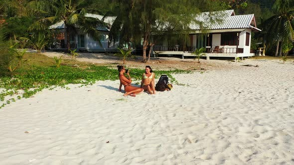 Thumbnail for Beautiful beauty models on holiday spending quality time at the beach on paradise white sand and blu