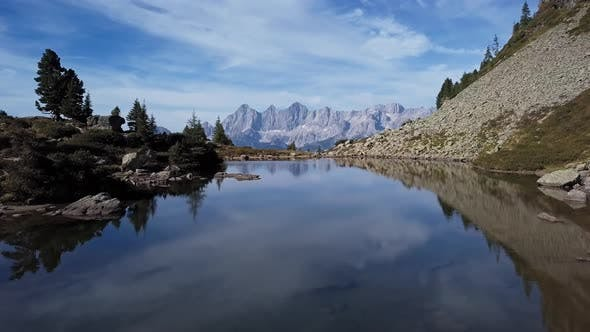 Aerial of Lake Spiegelsee with Reflections of Dachstein, Austria