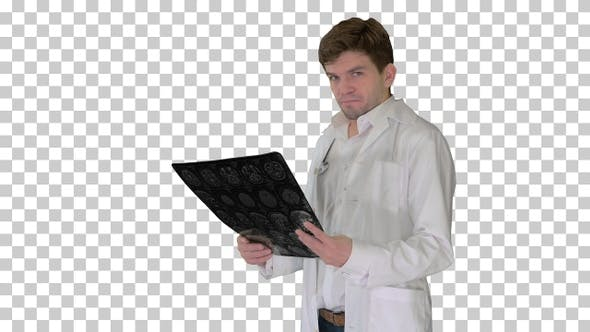 Thumbnail for Upset male doctor looking at x-ray MRI image and looking