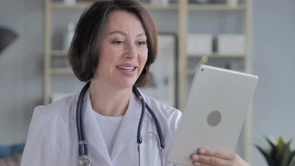 Thumbnail for Online Video Chat Old Lady Doctor Via Tablet