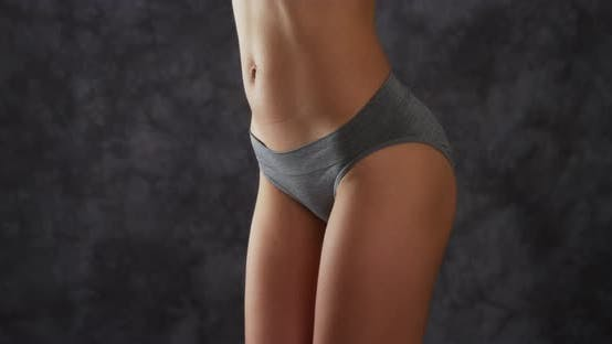 Thumbnail for Attractive woman standing in gray underwear