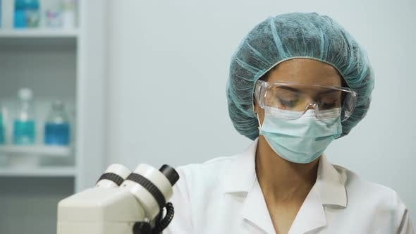 Thumbnail for Biracial Laboratory Assistant Checking Liquids in Medical Tubes on Transparency