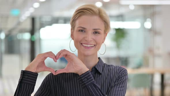 Loving Businesswoman Showing Heart Sign with Hand