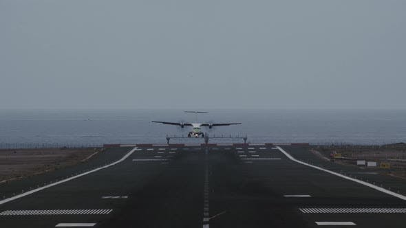 Thumbnail for Airplane Coming in for Landing on Runway Overlooking Ocean