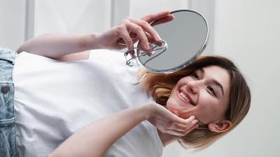 Skin Care Morning Routine Woman Looking in Mirror