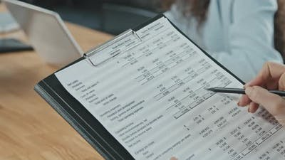 Close Up of Business Documents with Figures