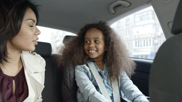 Thumbnail for Mom and Daughter Riding in Car