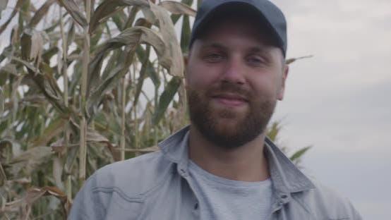 Thumbnail for Cheerful Farmer in Corn Field