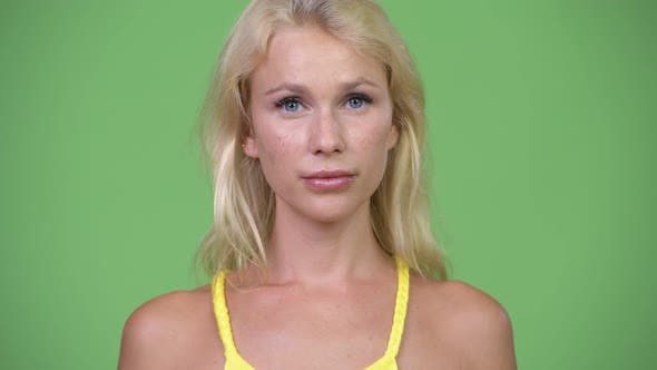 Thumbnail for Young Happy Beautiful Woman with Blond Hair Against Green Background