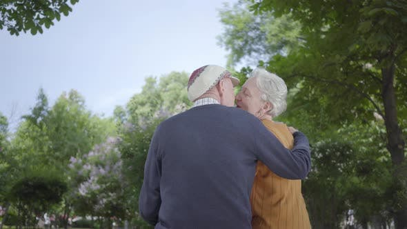 Thumbnail for Portrait Mature Couple in Love Sitting on a Bench in the Park