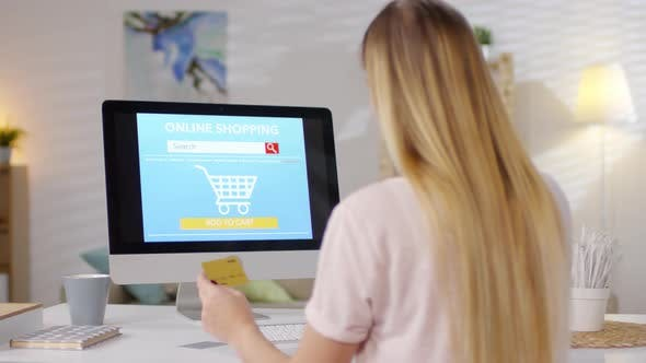 Cover Image for Woman Shopping Online on Desktop Computer
