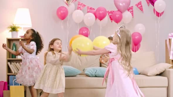 Cover Image for Girls Tossing Balloons in the Air