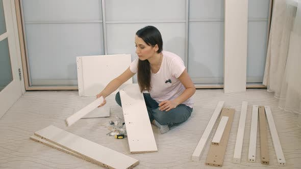 Woman Try To Assemble Furniture