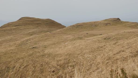 Hikers near Stara planina mountain top  4K 2160p 30fps UltraHD footage - Group of mountaineers  on M