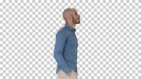 Thumbnail for Confident in his style model walkin with hands in pockets