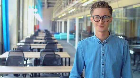 Thumbnail for Male Employee with Glasses Posing at Workplace
