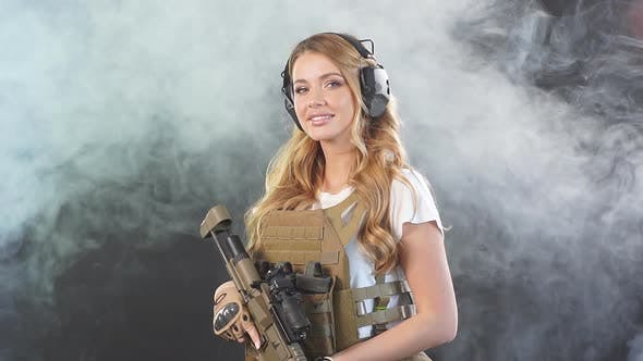 Thumbnail for Female Private Military Contractor Dressed in Tactical Uniform Armed with Riffle, Slow Motion