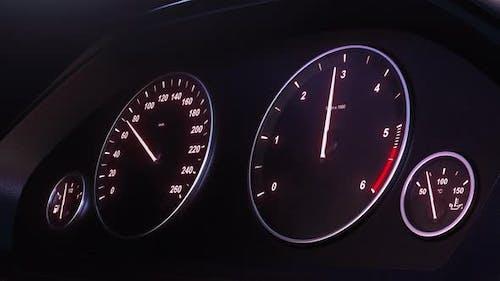 Car Speedometer Picking Up Speed at Night
