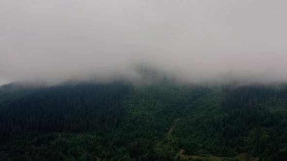Cover Image for Aerial View Over Foggy Mountains After Rain V2