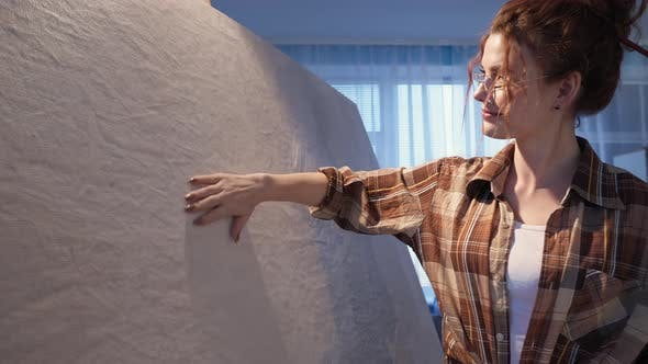 Hobby in Home Studio Inspiring Creative Artist Girl in Eyeglasses with Paintbrush in Hair Stroking