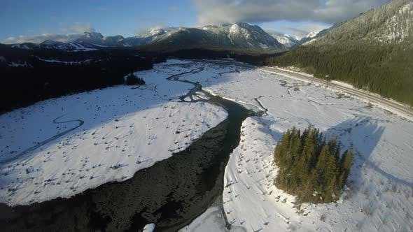 Thumbnail for Breathtaking Mountain Aerial Over Frozen Lake By Washington Freeway