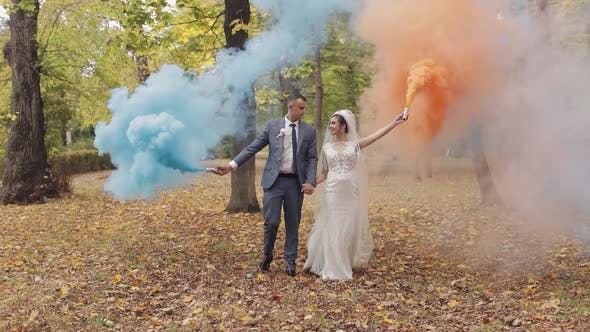 Thumbnail for Caucasian Groom with Bride in the Park. Wedding Couple. Smoke Bombs. Newlyweds