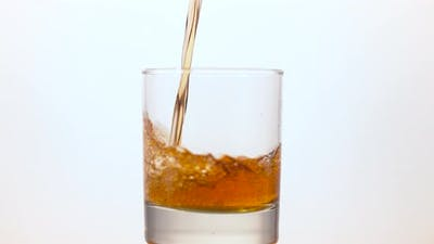 Whisky pouring into a glass