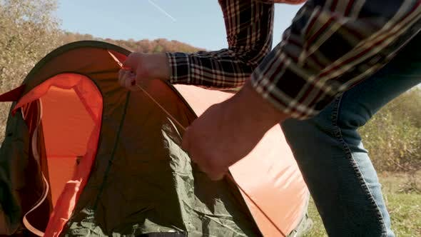 Cover Image for Close Up View of Man Checking the Camping Tent