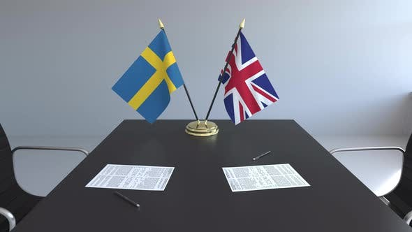 Flags of Sweden and the United Kingdom on the Table