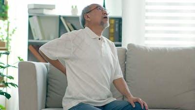 Asian Elderly senior man back pain and illness
